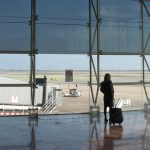 woman-with-trolley-looking-for-planes-at-barcelona-airport-1225095-640x360