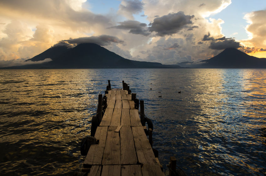 24964977 - sunset on lake atitlan with volcano in background