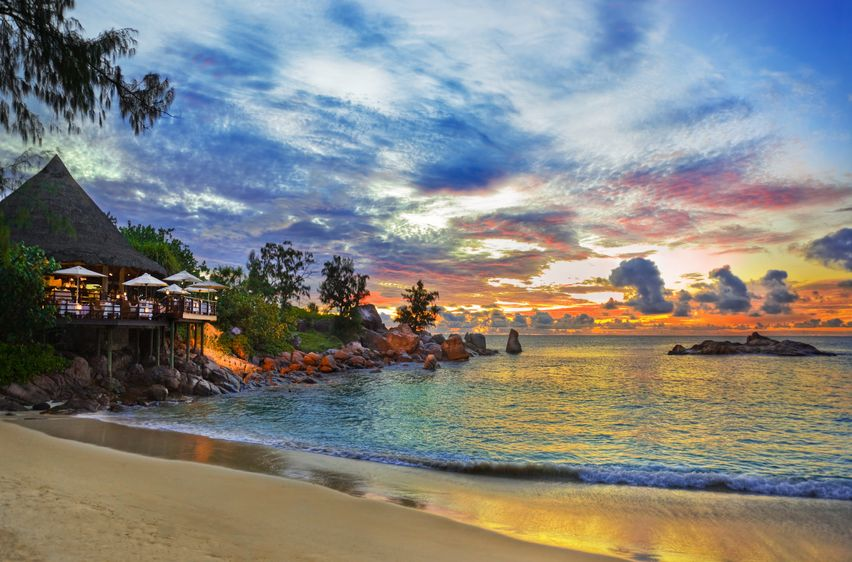 10294406 - cafe on tropical beach at sunset - nature background