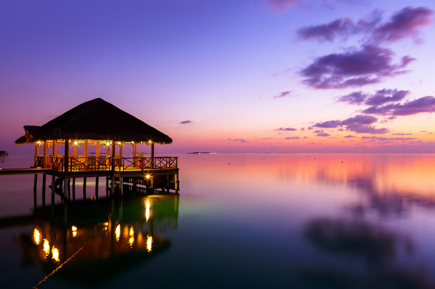 38993267 - water cafe at sunset - maldives vacation background